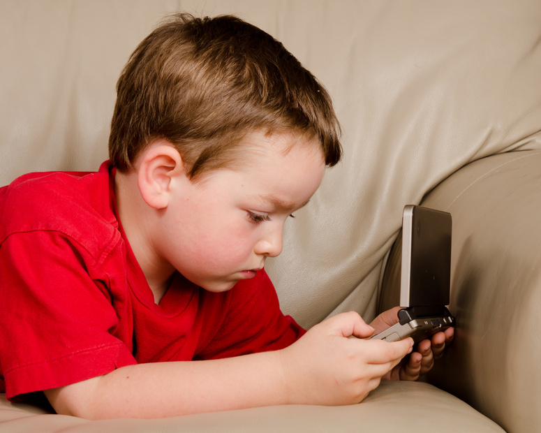 Couch potato concept of boy playing video game